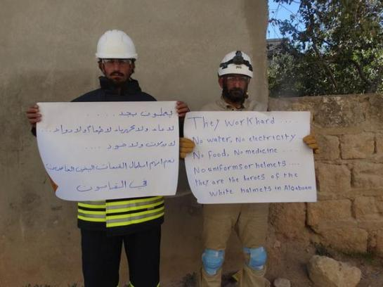 Syrian Civil Defense members supporting volunteers in the al-Qaboun neighborhood of Damascus, where 17 children were killed by mortar fire on a school yesterday.