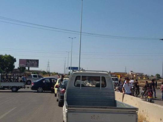 Protestors blocking the road to Tir Maela in Homs.